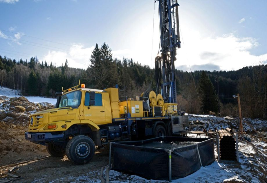 Photo: Yellow drilling vehicle with drilling device in the mountains